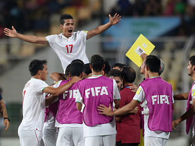 Iran players celebrate a goal against Germany. Getty