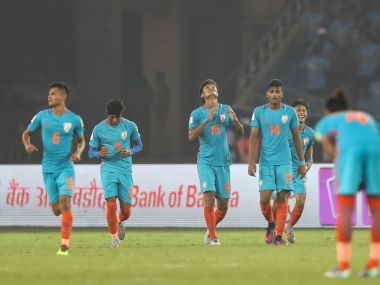Jeakson Singh Thounaojam celebrates with his team-mates after scoring India's first World Cup goal. Getty Images