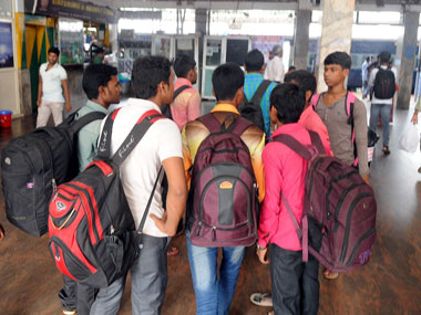 Migrant workers flock at Kannur railway station. Image courtesy SK Mohan