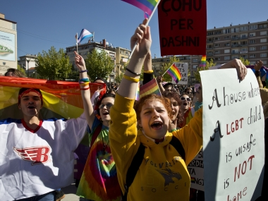 LGBT rights groups and supporters of the community hold banners during the Kosovo's first Gay Pride parade. AP