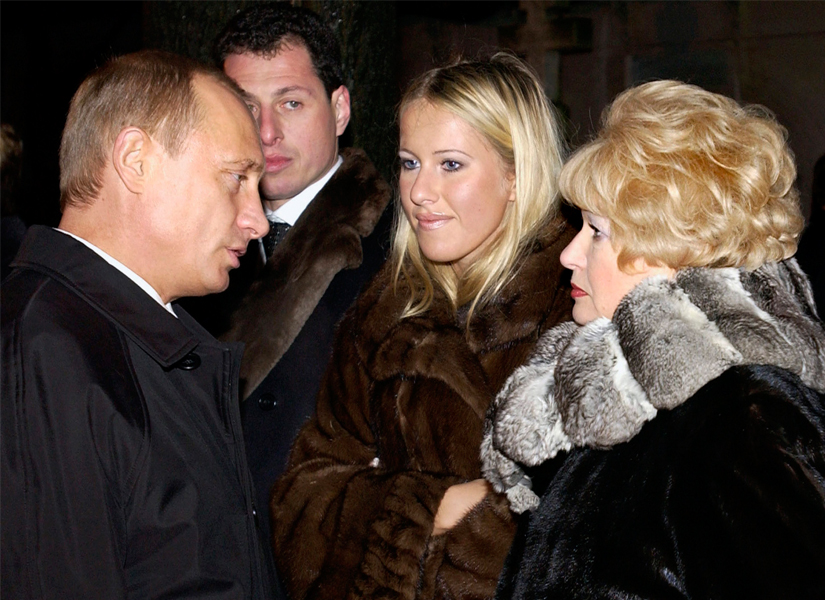 File image of Vladimir Putin with Ksenia Sobchak (centre) with her mother. AP