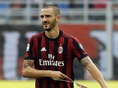 AC Milan's Leonardo Bonucci removes the captain's armband after receiving a red card from the referee during a Serie A match between AC Milan and Genoa. AP