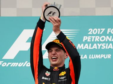 Max Verstappen holds his trophy aloft after winning the Malaysian Grand Prix. AP
