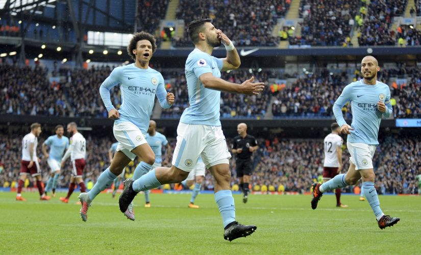 Manchester City's Sergio Aguero, centre, celebrates after scoring his side's first goal during their Premier League match against Burnley. AP