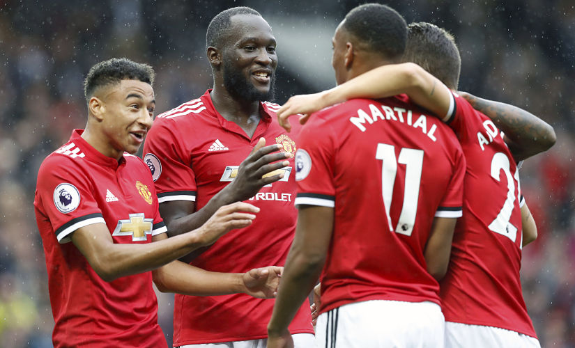 Manchester United's Romelu Lukaku celebrates scoring his side's fourth goal of the game with team-mates during the match with Crystal Palace. AP