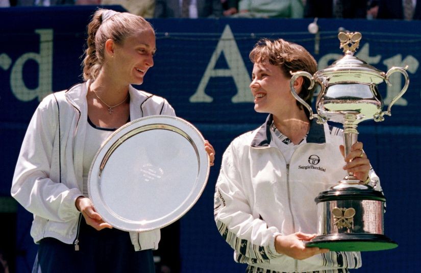 Martina Hingis (R) laughs with  Mary Pierce during the Australian Open trophy presentation after their final match. Sixteen-year-old Hingis beat Pierce 6-2 6-2 to become the youngest player to win a professional Grand Slam title. Reuters