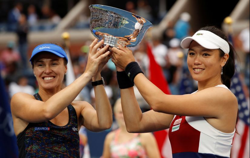Martina Hingis and Yung-Jan Chan hold the ?US Open trophy after their win against Lucie Hradecka and Katerina Siniakova. This women's doubles title was the final Slam that Hingis own. Reuters