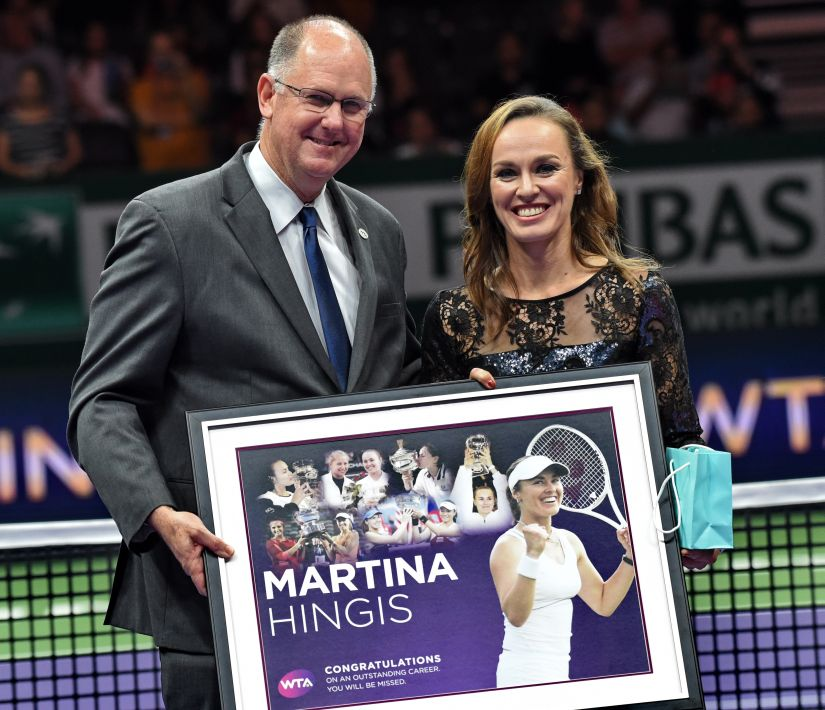 Martina Hingis poses with Steve Simon, WTA CEO, during her retirement ceremony at the WTA Finals. AFP