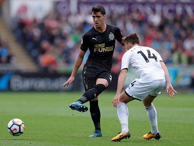 Newcastle United's Mikel Merino in action with Swansea City's Tom Carroll. Reuters