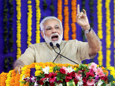Narendra Modi addresses a public meeting in his home town Vadnagar on Sunday.  PTI