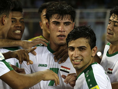 Iraq's teammates congratulate Mohammed Dawood after his goal against Chile. AP