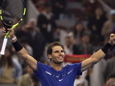 Rafael Nadal of Spain celebrates after beating Grigor Dimitrov of Bulgaria in their men's singles semifinal match in the China Open tennis tournament at the Diamond Court in Beijing, Saturday, Oct. 7, 2017. (AP Photo/Mark Schiefelbein)
