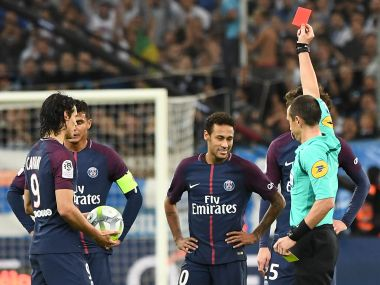 File image of referee Ruddy Buquet showing a red card to PSG's forward Neymar. AFP