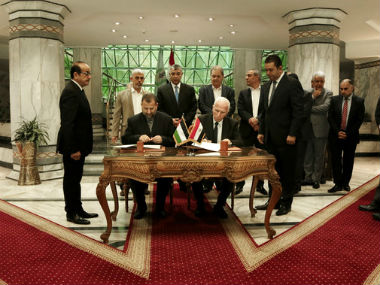 Representatives of the Fatah and Hamas sign the deal in Cairo on Thursday. AP