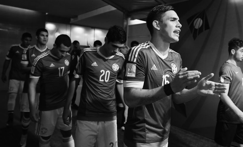 Anibal Vega of Paraguay spurs on his team as they walk out against Turkey in Navi Mumbai. Getty Images