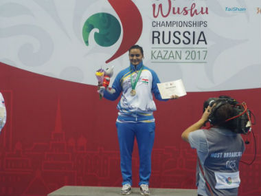 Pooja Kadian poses after winning gold medal at the Wushu World Championship. Twitter: @CRPF