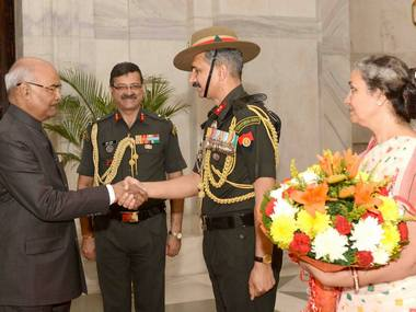 A Territorial Army officer accompanied by his wife meeting with President Ram Nath Kovind at Rashtrapati Bhavan, New Delhi on Monday. PTI