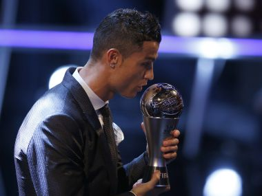 Cristiano Ronaldo holds the FIFA Player of the Year Award at the Palladium Theatre in London on Monday. AP