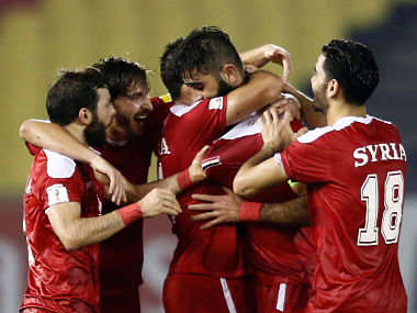 Football Soccer - China v Syria - World Cup Group A Qualifier - Hang Jebat Stadium, Malacca City, Malaysia - 13/06/17 - Syria's Ahmad Alsaleh celebrates with teammates after scoring an equalizer against China REUTERS/Lai Seng Sin - RC156E076090