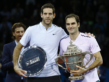 Tennis - ATP 500 - Swiss Indoors Basel - Final - St. Jakobshalle, Basel, Switzerland - October 29, 2017 - Juan Martin del Potro of Argentina and Roger Federer of Switzerland pose with the trophies after the final match. REUTERS/Arnd Wiegmann - HP1EDAT1BXX3Y