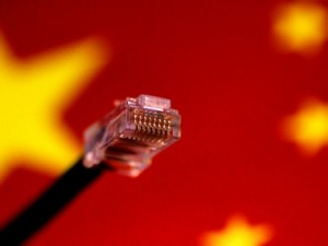 A computer network cable is seen above a Chinese flag. Reuters