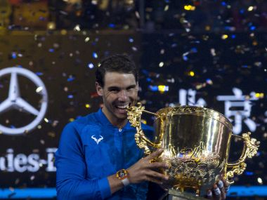 Rafael Nadal of Spain poses with this trophy after defeating Nick Kyrgios of Australia in the men's singles final match in the China Open tennis tournament at the Diamond Court in Beijing, China, Sunday, Oct. 8, 2017. (AP Photo/Ng Han Guan)