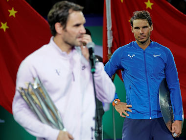 Roger Federer of Switzerland and Rafael Nadal of Spain after the match. Reuters