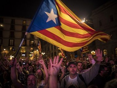 Pro-independence supporters cheer and wave pro independence flags in Barcelona. AP