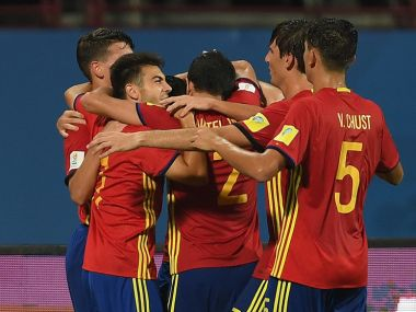 Cesar Gelabert of Spain is mobbed by team mates after scoring his team's 2nd goal against North Korea. Getty