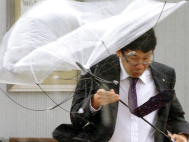 A man walks in a strong wind caused by a powerful typhoon in Iwaki, Fukushima prefecture on Monday. AP