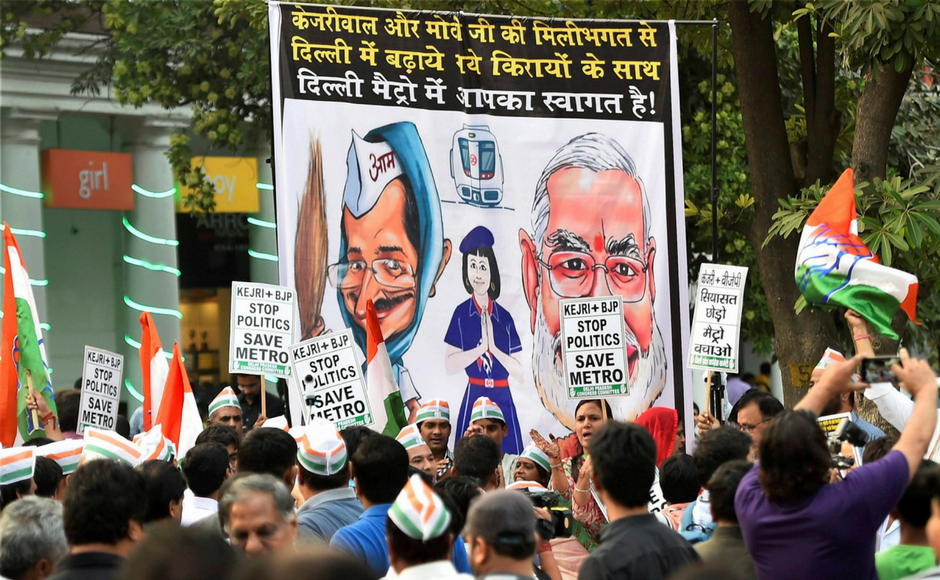 """Delhi Congress workers during the launch of their week-long """" Kejriwal+BJP, Stop Politics, Save Metro"""" campaign at Rajiv Chowk Metro Station in New Delhi on Wednesday. PTI"""