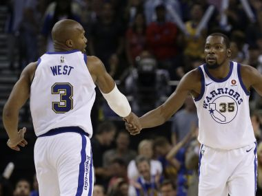 Golden State Warriors' Kevin Durant, right, celebrates a score against the Washington Wizards with David West. AP