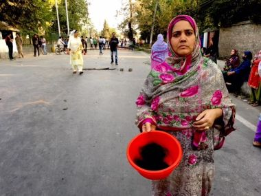 A woman protester in Bagat area of Srinagar showing the hair of a chopped braid of one of her relatives. Image procured by Sameer Yasir.