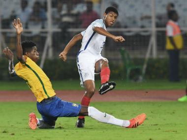 Rhian Brewster (L) of England in action against Brazil in the FIFA U-17 World Cup semi-final in Kolkata. AFP