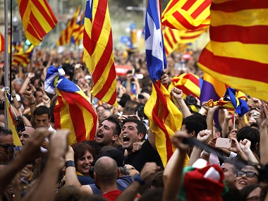 People celebrate declaration of independence of Catalonia outside the Catalan Parliament. AP
