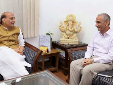A file photo of former IPS officer Dineshwar Sharma and Union minister Rajnath Singh. PTI