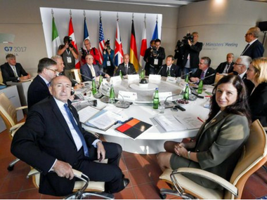 The G7 ministers, two EU commissioners and the Interpol secretary general attend the round table of the opening session of a G7 of Interior Ministers, on the island of Ischia, near Naples, Italy. AP