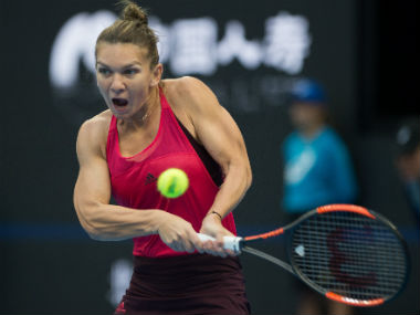 Simona Halep hits a return during her women's singles match against Maria Sharapova at the China Open. AFP