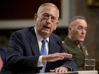 Jim Mattis sits before the Senate Armed Services Committee. AP