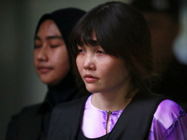 Vietnamese Doan Thi Huong, escorted by police as she leaves after the court hearing at Shah Alam court house in Shah Alam, outside Kuala Lumpur, Malaysia, Tuesday. AP