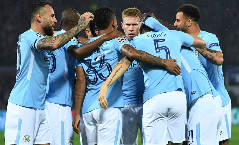 (FILES) This file photo taken on September 13, 2017 shows Manchester City's English defender John Stones (2R) celebrates with teammates after scoring a goal during the UEFA Champions League Group F football match between Feyenoord Rotterdam and Manchester City at the Feyenoord Stadium in Rotterdam, on September 13, 2017. Manchester City and Napoli are the two most prolific teams in Europe's five major leagues, making the October 17 Champions League encounter at the Etihad Stadium a genuinely mouth-watering prospect. / AFP PHOTO / Emmanuel DUNAND