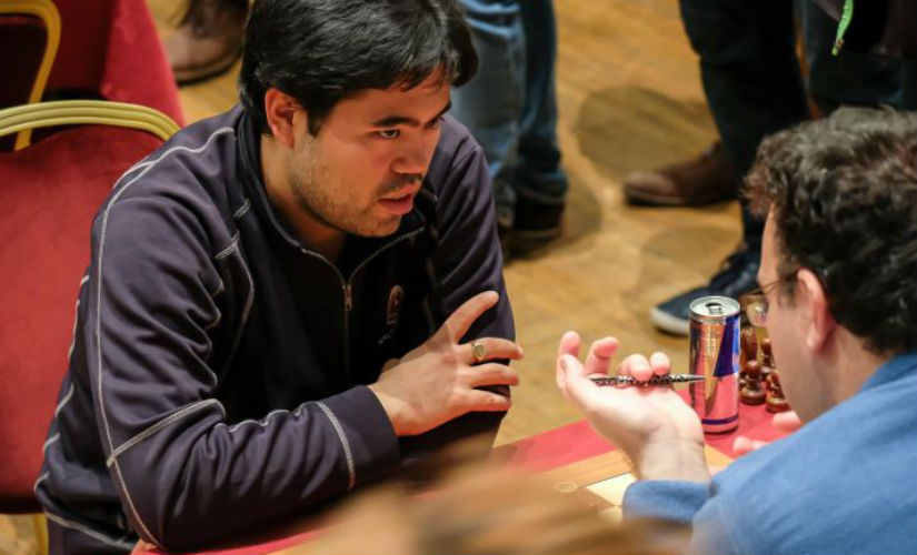 Hikaru Nakamura (L) knew way too well how to handle an overly aggressive opponent in Emil Sutovsky. John Saunders