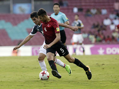 Turkey's player Abdussamed Karnucu duels for the ball against Paraguay's Alexis Duarte during the FIFA U-17 World Cup match in Mumbai. AP