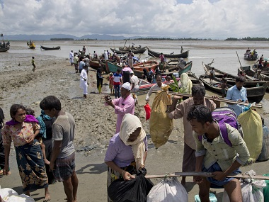 Rohingya Muslims from Myanmar disembark from boats as they continue their journey to Bangladesh. AP
