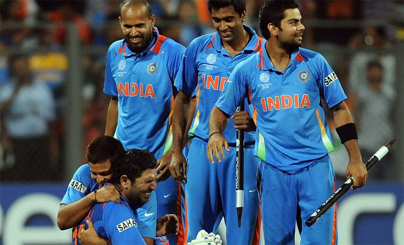 Yuvraj Singh in tears as his India teammates embrace him as they celebrate winning the 2011 World Cup. AFP