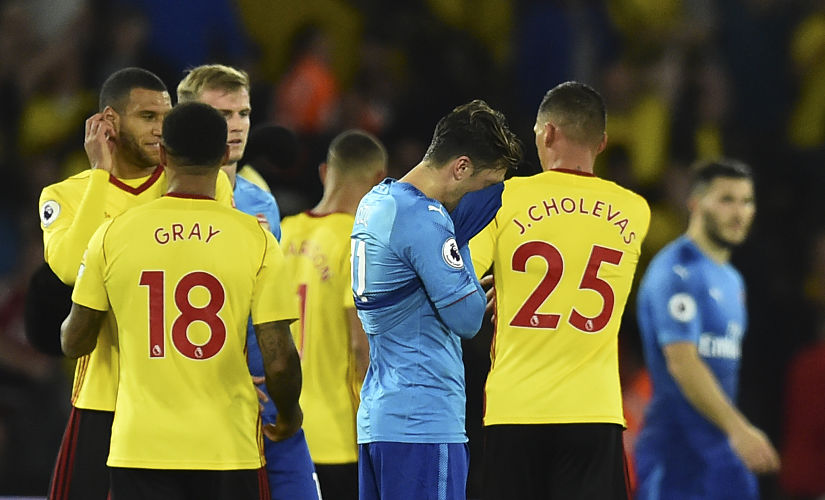 Arsenal's German midfielder Mesut Ozil (C) reacts at the final whistle during the English Premier League football match between Watford and Arsenal at Vicarage Road Stadium in Watford, north of London on October 14, 2017. Watford won 2-1. / AFP PHOTO / Glyn KIRK / RESTRICTED TO EDITORIAL USE. No use with unauthorized audio, video, data, fixture lists, club/league logos or 'live' services. Online in-match use limited to 75 images, no video emulation. No use in betting, games or single club/league/player publications. /