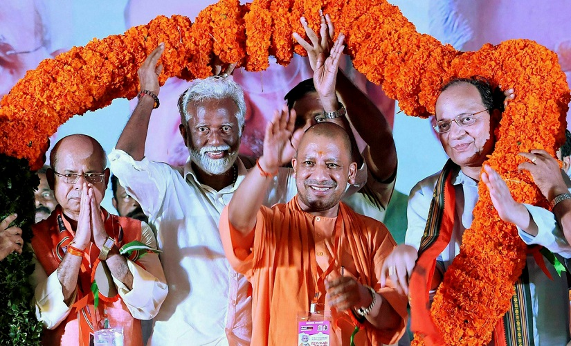 Uttar Pradesh chief minister Yogi Adityanath, BJP state president Kummanam Rajasekharan and other national leaders being felicitated at a public meeting as part of 'Janaraksha Yathra' in Kannur. PTI