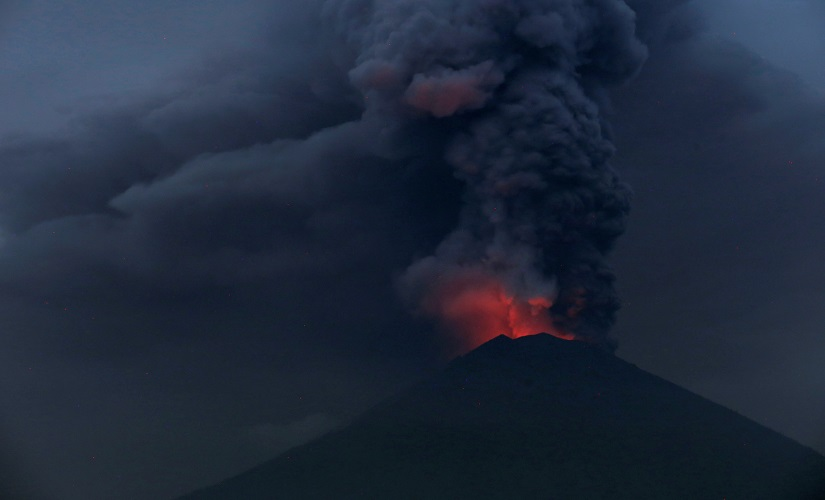 Glowing light of hot lava is seen during the eruption of Mount Agung. Reuters