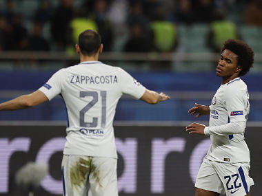 Chelsea's Willian, right celebrates with teammate Chelsea's Davide Zappacosta after scoring his sides fourth goal of the game during their Champions League, group C, soccer match between Qarabag FK and Chelsea at the Baku Olympic stadium in Baku, Azerbaijan, Wednesday, Nov. 22, 2017. (AP Photo/Pavel Golovkin)