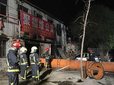 Firefighters work at the site of a fire in Daxing district of Beijing, China. AP